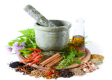 Herbs and spices with mortar and bottle with oil